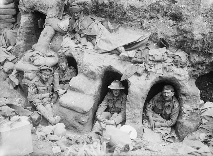 WW1: Men of the Border Regiment resting in shallow dugouts near Thiepval Wood during the Battle of the Somme in August 1916.