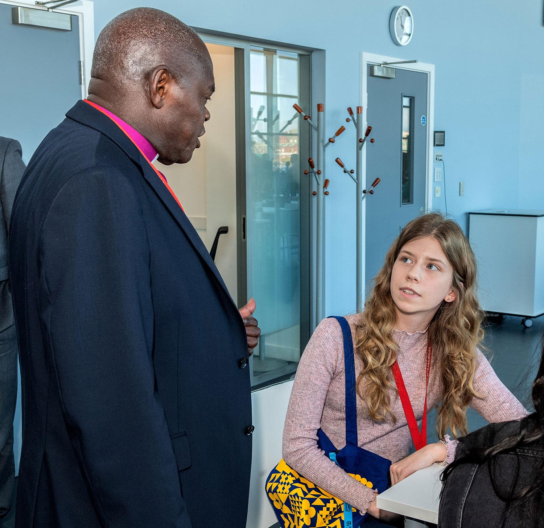 Abbie talking with the Archbishop of York John Sentamu