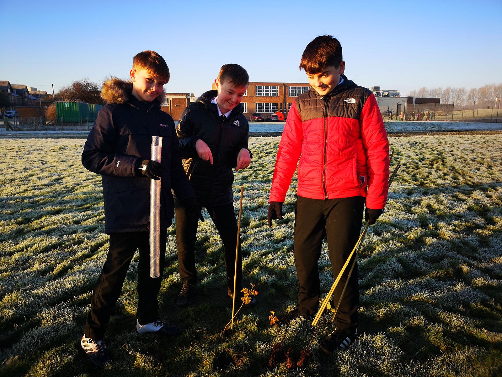 boys-planting-tree